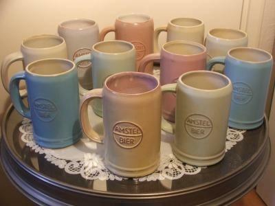Complete verzameling van Amstel Bierpullen in pastelkleuren