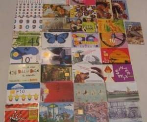 42 diverse telefoonkaarten/pasjes