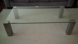 Glazen salontafel met rvs poten