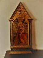 """Paneel """"De Madonna van de Rozenhaag""""naar Martin Schongauer."""