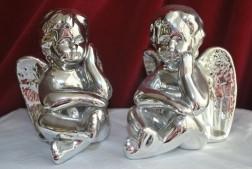 2x Stenenbeeldjes met Zilverkleuring