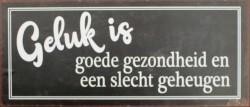 Tekstbord:'Geluk is goede gezondheid en een slecht geheugen…
