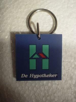 """Sleutelh."""" De hypotheker"""", NIEUW, zacht plastic"""