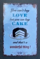 """Tekstbord: """"You can't buy love but you can buy cake and tha…"""