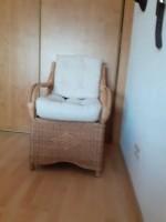 Vier nette rotan fauteuils