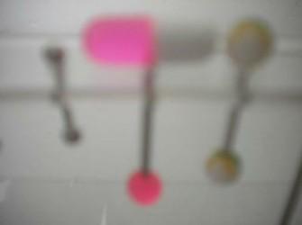 tongpiercing wit/roze