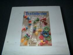 Textiele Sier.